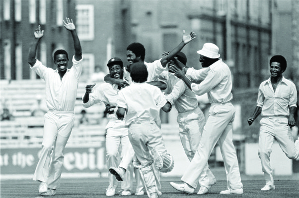 Image Caption: 5th Test England v West Indies at The Oval 1976 Michael Holding celebrates the dismissal of Tony Greig (E765044)  61370-11A photograph by Patrick Eagar—Click to read this article.